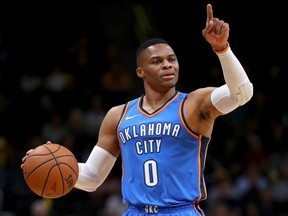 Russell Westbrook #0 of the Oklahoma City Thunder brings the ball down the court against the Denver Nuggets at the Pepsi Center on October 10, 2017 in Denver, Colorado.