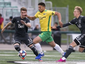 Captain Jordian Farahani with the Saskatchewan Selects all-star squad moves the ball away from the Vancouver Whitecaps U-23 team during a SK Summer Series friendly soccer match in Saskatoon, SK on Thursday, July 25, 2019.
