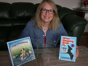 Saskatoon singer/songwriter and author Sally Meadows displays her most recent books, including The Underdog Duckling which earned her a 2019 Word Award in the children's picture book category. (Supplied photo) (for Darlene Polachic column)
