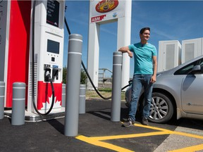 Adrian Dean, a member of the Saskatchewan Electric Vehicle Association, charges his 2011 Nissan Leaf at Petro-Canada's EV Fast Charge station on the city's east end.