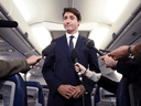 Liberal Leader Justin Trudeau speaks on his campaign plane regarding a 2001 photo that surfaced of him wearing brownface, Sept. 18, 2019.