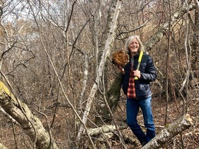 Forager Curtis Reid with a big chunk of chaga he removed from a birch tree. (Supplied photo/Jenn Sharp)
