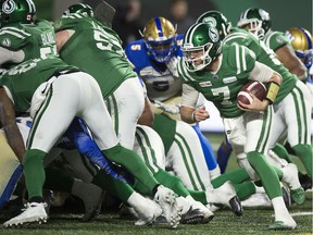 Saskatchewan Roughriders quarterback Cody Fajardo, right, was stuffed for a loss of one on this quarterback sneak late in the fourth quarter of Sunday's CFL West Division final against the visiting Winnipeg Blue Bombers.
