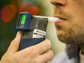 Scott McGregor, SGI Communications Consultant, tests out an approved screening device for alcohol, commonly referred to as a breathalyzer, at a demonstration on the tools the Saskatoon Police Service is using to combat impaired driving. Photo taken in Saskatoon, on Dec. 9, 2019.