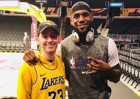 Corey Groves, left, with hero LeBron James on Christmas Day in Los Angeles