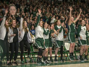 Players on the University of Saskatchewan Huskies' bench cheer during their Canada West conference win against the University of Alberta Pandas on Friday, February 28, 2020. The Huskies enter this week's U Sports Final 8 national championship tournament as the No. 1 seed and favourite.