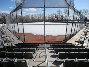 A softball diamond at the Gordie Howe Sports Complex is seen empty, covered with snow, in Saskatoon on April 16, 2020. Sports fields in Saskatoon are off-limits until at least July.