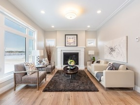 The show home at 302 Boykowich Street combines traditional elements with a modern west coast vibe. The living room features a very traditional layout with a fireplace. A herring-bone tiled fireplace surround with white mantel will serve as a gathering place for family and friends. (Sask Real Estate/David Oh)