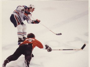 In this file photo from Dec. 30, 1981, Wayne Gretzky gets past Flyers Bill Barber to score his 50th goal.