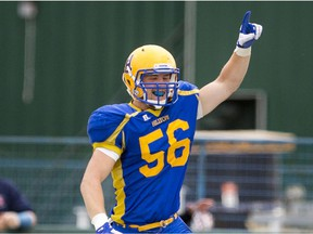 Former Saskatoon Hilltops rush end Tom Schnitzler, shown here celebrating a fumble recovery for a touchdown against the Winnipeg Riffles during the 2015 season, was selected in the 2020 CFL Draft by the Hamilton Ti-Cats after two seasons with the UBC Thunderbirds.