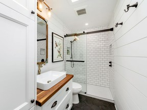 The mix of contrasting neutrals and textures, such as the white and black tile and the warm wood vanity top, are just a few ideas to get your creative juices going as you plan your next home renovation project.
