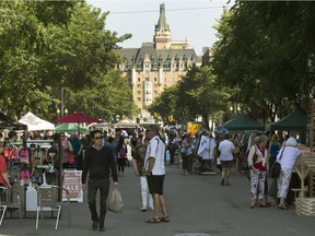 Shoppers look for sales during the annual Second Avenue Sidewalk Sale, July 11, 2014.