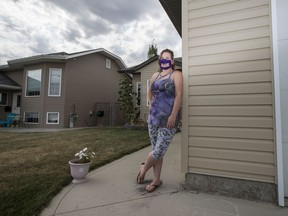 """Gale Estell outside of her home in Martensville, SK on Saturday, August 22, 2020. Estell says that navigating the world before COVID-19 was a struggle for her as a deaf woman, but now she's felt an increased sense of anxiety when in public. She relies on reading lips to understand people but full coverage face masks feels like there is a """"blanket over communication."""" While she supports the use of masks, she hopes that more people, and especially health centres, will adopt the window face masks for more accessibility of people who are deaf and hard of hearing."""