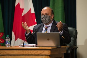 Saskatchewan's chief medical health officer Dr. Saqib Shahab, right, speaks to media regarding the COVID-19 pandemic during a news conference at the Saskatchewan Legislative Building in Regina, Saskatchewan on Sept. 17, 2020. Shahab is seen wearing a mask, which he briefly put on as he was speaking about mask usage.