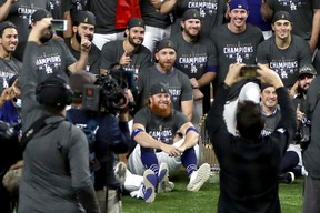 Justin Turner #10 and the Los Angeles Dodgers pose for a photo after defeating the Tampa Bay Rays 3-1 in Game Six to win the 2020 MLB World Series at Globe Life Field on October 27, 2020 in Arlington, Texas.