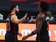 Jan 16, 2021; Tampa, Florida, USA; Toronto Raptors guard Fred VanVleet (23) and forward OG Anunoby (3) high five during the second half against the Charlotte Hornets at Amalie Arena. Mandatory Credit: Kim Klement-USA TODAY Sports