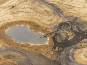 A trench cuts into a wetland in order to drain it, and prepare it for cultivation. The dark areas used to be wetlands. MICHAEL BELL / Regina Leader-Post.