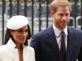 In this file photo taken on March 12, 2018 Britain's Prince Harry and his fiancee US actress Meghan Markle attend a Commonwealth Day Service at Westminster Abbey in central London, on March 12, 2018.