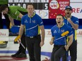 Team Alberta third Darren Moulding,(R-L), second Brad Thiessen and lead Karrick Martin celebrate after defeating Saskatchewan in the 2021 Brier semifinal. Team Alberta takes on Calgary's Kevin Koe (Wild Card 2) in the final. (Curling Canada/ Michael Burns Photo)