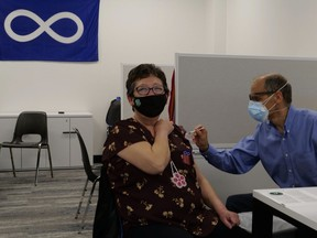 Verna McCallum receives the COVID-19 vaccine at the MN–S pop-up vaccination clinic in Saskatoon on April 23, 2021.