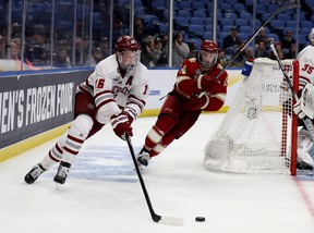 Now a defenceman with the Colorado Avalanche, Canadian Cale Makar (left) of the Massachusetts Minutemen carries the puck against the Denver Pioneers during the semifinals of the NCAA Men's Frozen Four tournament in Buffalo in 2019. This year's semifinals begin Thursday.