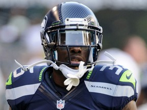 Seattle Seahawks defensive back Phillip Adams warms up prior to the NFL game against the Tennessee Titans at CenturyLink Field in Seattle, Washington, U.S. August 11, 2012.