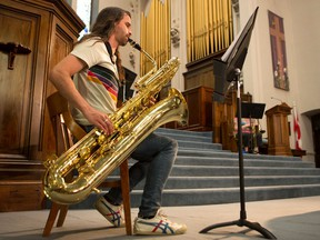 Gerard Weber plays the bass saxophone in a rehearsal at Knox United Church for a special concert featuring the lowest acoustic instruments with the Strata New Music Festival. Photo taken in Saskatoon on May 18, 2021.
