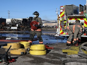 Firefighters work at the scene of a fire that destroyed a building in the 100 block of Avenue B South. Photo taken in Saskatoon on Monday May 3, 2021.