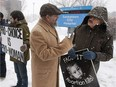 People on opposite sides of the abortion debate demonstrate in front of City Hospital in February 2013.
