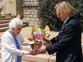 Queen Elizabeth II receives a Duke of Edinburgh rose, given to her by Keith Weed, President of the Royal Horticultural Society, at Windsor Castle on June 9, 2021 in Windsor, England.