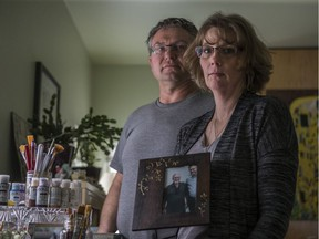 Carey Rigby-Wilcox, right, and Rich Wilcox, are pictured at their home near Pike Lake in January 2020. Their son, Steven Rigby died in an officer-involved shooting in December 2018. An inquest into his death begins June 21.