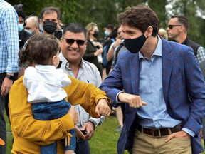 Canada's Prime Minister Justin Trudeau greets people at Town Centre Park in Coquitlam, British Columbia, Canada July 8, 2021.