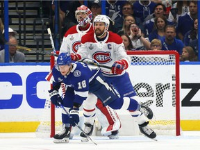 Tampa Bay Lightning's Ondrej Palat battles with Montreal Canadiens' Shea Weber in front of Carey Price during the first period in Game 5 of the Stanley Cup Final, Wednesday July 7, 2021 at Amalie Arena in Tampa.