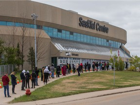 A line of people wait to receive their dose of COVID-19 vaccine at the clinic run by the Saskatoon Tribal Council at SaskTel Centre. Photo taken in Saskatoon, SK on Friday, May 21, 2021.