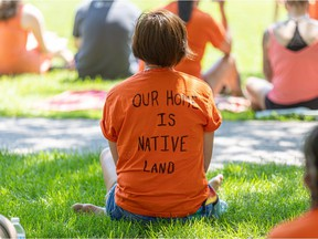 """A shirt reads """"Our Home is Native Land"""" at Kiwanis Park during the Bring Them Home event, which is a time for mourning and reflection for the residential school children instead of regular Canada Day celebrations."""