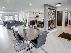 When transforming this 1980s-era bungalow at 123 Gathercole Cres., Studio 2.0 Interior Design knocked down multiple interior walls to create an inviting open concept great room. A custom crafted powder-coated aluminum divider creates separation between the foyer and the kitchen.
