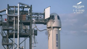 This still image taken from video by Blue Origin shows the launch pad as Mark Bezos, Jeff Bezos, Wally Funk and Oliver Daemen wait for take off to travel for the first crewed flight of Blue Origin's reusable New Shepard craft, on July 20, 2021, in Van Horn, Texas.