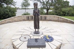"""The statue, """"Bitter Memories of Childhood"""" on the legislative grounds commemorating Ukrainians killed in the Holodomor shows why we need a similar residential school memorial. (Photo: Postmedia)"""
