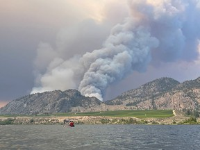 Smoke billows from a wildfire near Osoyoos, B.C., on July 19, 2021, in this picture obtained from social media.