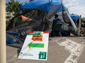 A COVID-19 pop-up vaccination clinic is set up at the 7th annual Food Truck wars street festival.