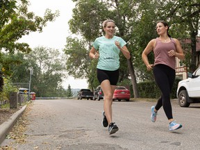 Physiotherapist Kim Fraser (right) runs with client Heather Morrison outside Still Physiotherapy