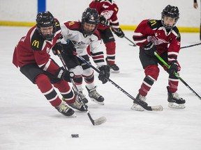 Members of the Redwing Thunder (red) squared off against the Bobcat Heat in their first Under-11 game of the year on Friday, November 20, 2020.