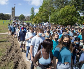 Thousands of people march against sexual violence on campus at Western University for in London, Ont. on Friday. (Derek Ruttan/The London Free Press)