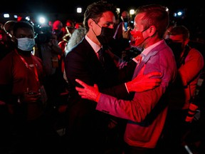 Prime Minister Justin Trudeau greets supporters as he leaves the Fairmount Queen Elizabeth Hotel after delivering his victory speech in Montreal on Tuesday morning.