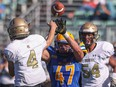 Saskatoon Hilltops defensive lineman Riece Kack tries to block a pass during first half action against Edmonton Huskies in a Prairie Football Conference game at SMF Field. Photo taken in Saskatoon on Sunday, October 3, 2021.