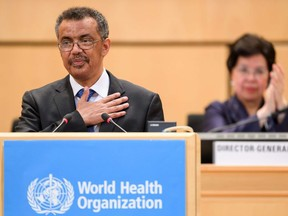 World Health Organization (WHO) Director General Ethiopia's Tedros Adhanom Ghebreyesus (L) reacts after his election in front of outgoing Director General China's Margaret Chan during the World Health Assembly (WHA) on May 23, 2017 in Geneva.