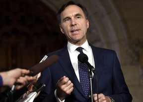 Minister of Finance Bill Morneau speaks to reporters in the Foyer of the House of Commons on Parliament Hill following Question Period, in Ottawa on Thursday, Oct. 26, 2017. THE CANADIAN PRESS/Justin Tang