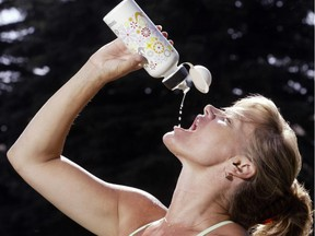 Unless you are an elite athlete, a drink from the tap is all you need, experts say. Grant Black/Postmedia News files