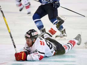 Canada's Chris Didomenico falls on the ice during the game between Dinamo Minsk and Team Canada, at the 90th Spengler Cup hockey tournament in Davos, Switzerland, on Dec. 26, 2016. Chris DiDomenico was about as far away from the NHL as possible three years ago. The former sixth round pick of the Toronto Maple Leafs was playing in an Italian hockey League, a top scorer with a club in Asiago, a tiny, scenic northern Italian town in the foothills of the Alps. (THE CANADIAN PRESS/Keystone via AP, Melanie Duchene)