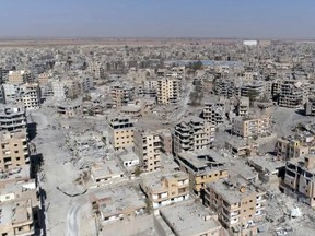 This Thursday, Oct. 19, 2017 frame grab made from drone video shows damaged buildings in Raqqa, Syria two days after Syrian Democratic Forces said that military operations to oust the Islamic State group have ended and that their fighters have taken full control of the city. (AP Photo/ Gabriel Chaim)